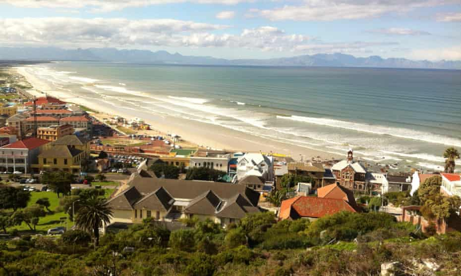 Muizenberg beach. with golden sand and long, gentle waves.