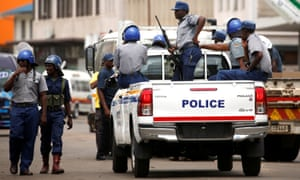 Police patrol the streets of Harare