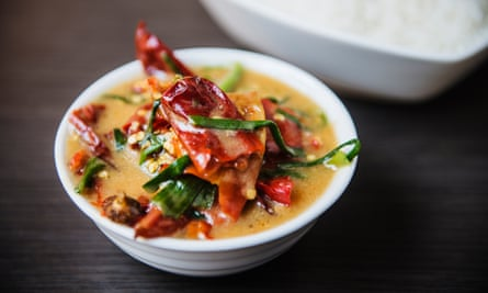 Dish of ema datshi (red rice with chillies and melted cheese).
