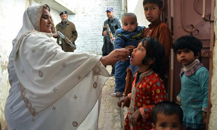 A Pakistani health worker administers polio drops to a child during a vaccination campaign in Quetta