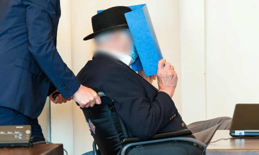 Bruno Dey, a former SS guard at the Stutthof concentration camp, is assisted in court.