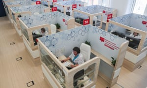 Employees of a telehealth centre at work in their socially distanced pods in Moscow, Russia. The centre was established to provide medical aid and psychological support to patients with coronavirus.