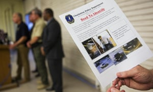 Charleston Emergency Management Director Mark Wilbert holds a flier, Thursday, June 18, 2015, distributed to media with surveillance footage of a suspect wanted in connection with a shooting Wednesday at Emanuel AME Church, in Charleston, S.C. (AP Photo/David Goldman)