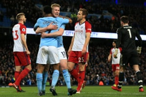 De Bruyne celebrates with Sterling after scoring the second for City.