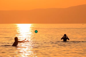 Fonyód, Hungary. Two women play with a ball at sunset in Lake Balaton
