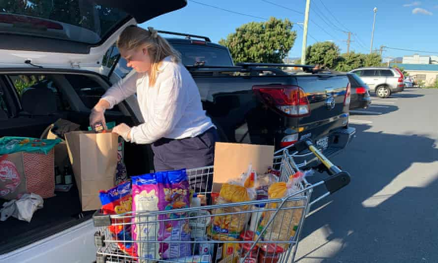 Keely Bell packs groceries destined for food parcels in Lyall Bay, Wellington.