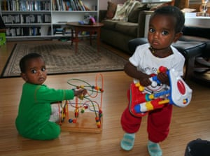Isabella (left) and Giulia play at home.