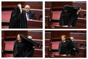 Pauline Hanson takes off a burqa during question time in the Senate