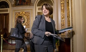 Amy Klobuchar heads to the Senate floor for the impeachment trial of Donald Trump in Washington DC, on 24 January.