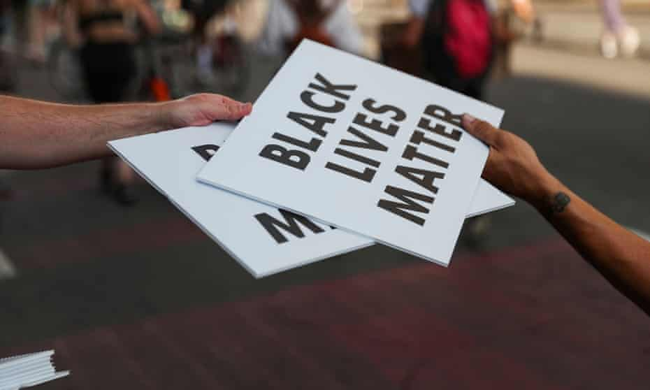 Protesters hold racial inequality protests near the White House in?Washington<br>Protesters carry Black Lives Matter signs on a road during racial inequality protests in downtown?Washington DC, U.S., June 23, 2020. REUTERS/Leah Millis