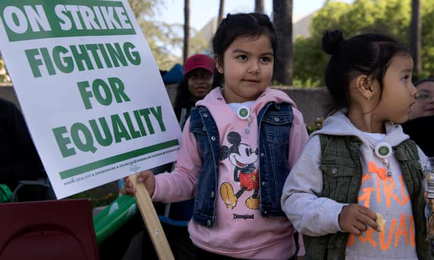 Children support their parents' cause as UC Service's workers begin a three-day strike in Orange County