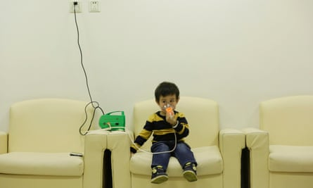 Hanhan, three, receives nebuliser therapy after a Beijing red alert for air pollution in 2015.