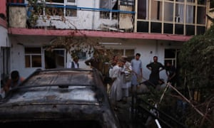Damage at the scene of an US drone attack near the Hamid Karzai International airport, in Kabul