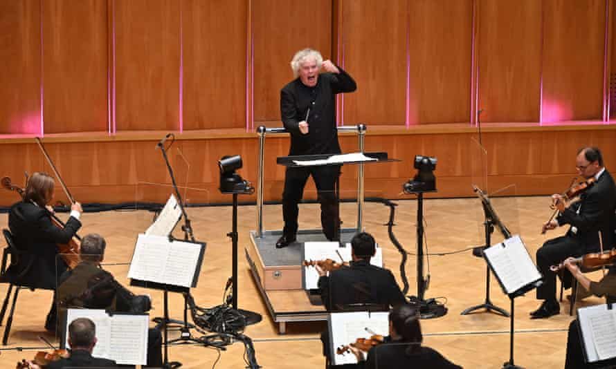 Sir Simon Rattle conducts the LSO at LSO St Luke's in London last year.