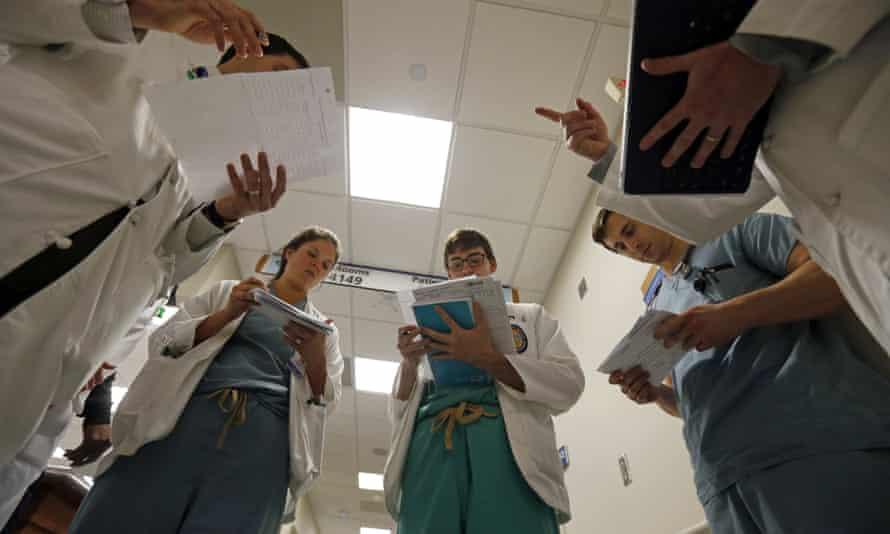 Trainee doctors read patient charts
