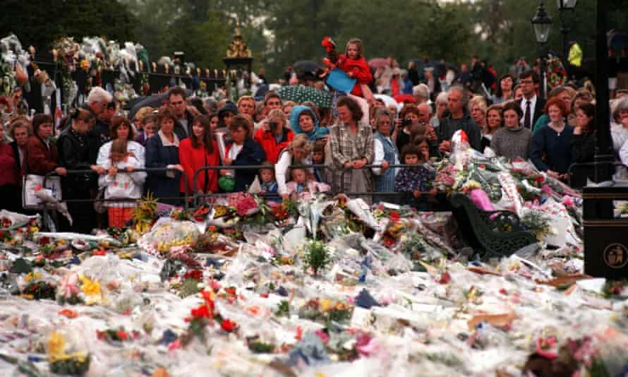 Thousands of mourners gather to lay flowers and cards at the gates of Kensington Palace in London.