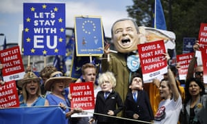 Anti-Brexit campaigners display puppets of Nigel Farage, Boris Johnson and Jeremy Hunt.