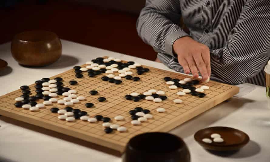 Fan Hui makes a move against AlphaGo in DeepMind's HQ in King's Cross.