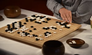 A grandmaster plays AlphaGo at the ancient Chinese game of go.