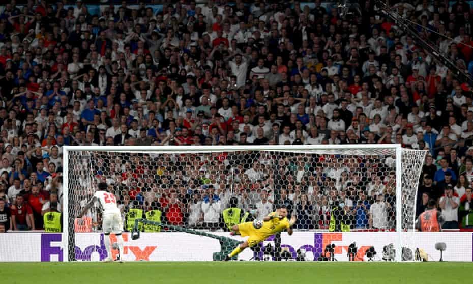 Bukayo Saka watches on as his decisive penalty is saved by Italy's goalkeeper, Gianluigi Donnarumma.