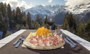 cheese and charcuterie with mountain view  at Rifugio Dosson.