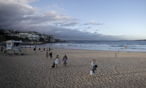 Swimmers leave the water at Bondi beach.