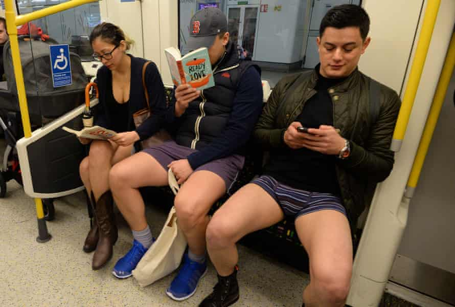 Tube travellers in London make themselves comfortable.