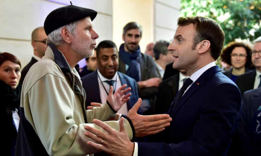 French mathematics teacher Pierre Coste speaking with President Emmanuel Macron about pensions