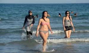It's a cover-up … Tunisian women at Ghar al Melh beach near Bizerte, north-east of Tunis