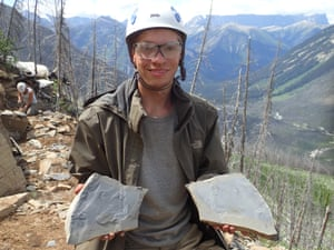 Joseph Moysiuk showing matching halves of a fossil slab while in Kootenay National Park on a Royal Ontario Museum field expedition in 2014.