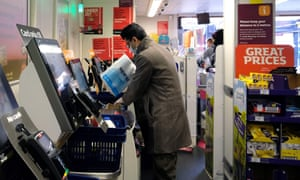 A shopper uses a checkout till at a Sainsbury's supermarket store.