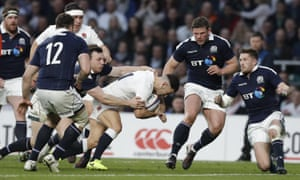 England's Danny Care drives over the line to score his team's sixth try.