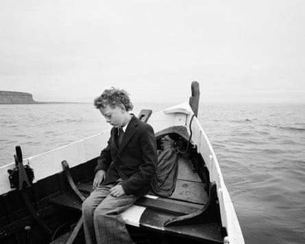 Simon being taken to sea for the first time since his father drowned, Skinningrove, North Yorkshire, 1983
