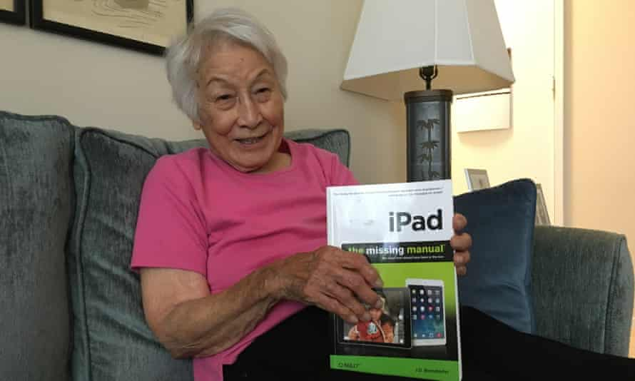 Rose Wong, 102-year-old tech reviewer, shows off her iPad manual.