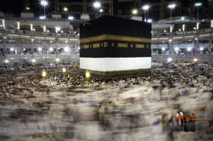 Muslim pilgrims performing Tawwaf, an anti-clockwise movement around the Islam's holiest shrine, the Kaaba