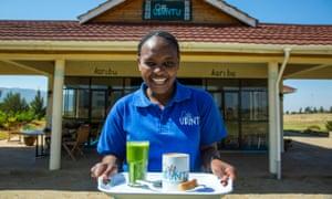 Ubuntu Cafe, Kenya, woman holding tray of drinks