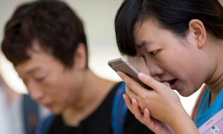 A customer tries out an iPhone's Siri at a Hong Kong Apple shop. Photograph: Jerome Favre/Bloomberg via Getty Images