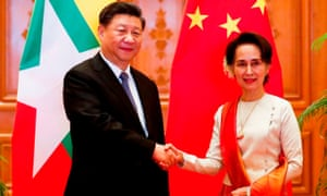 Xi Jinping and Aung San Suu Kyi shake hands at the Presidential Palace in Naypyidaw.
