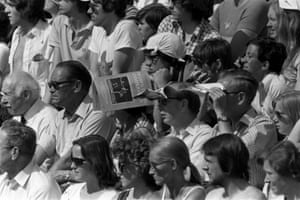 Spectators use a number of different methods to deal with the sun in 1975