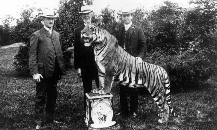 Animal collector Carl Hagenbeck with his sons and a Bengal tiger, 1907.