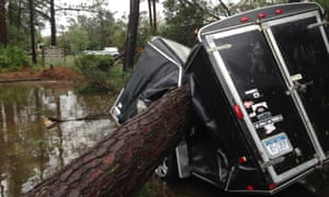 A trailer is crushed by a fallen tree in Hilton Head, South Carolina.