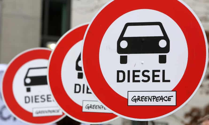 Protest banners outside a German federal parliament hearing on the Volkswagen emissions scandal, which has had a knock-on effect on UK car sales.