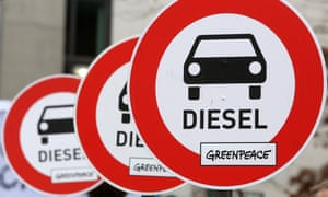 Unofficial traffic signs protesting about the danger of diesel cars are held aloft during a march to the Bundestag in Berlin in March.