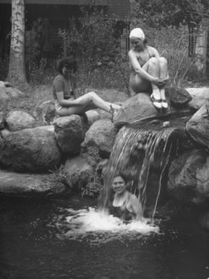 Vacationers cooling off in a stream at the bottom of the Grand Canyon at Phantom Ranch.