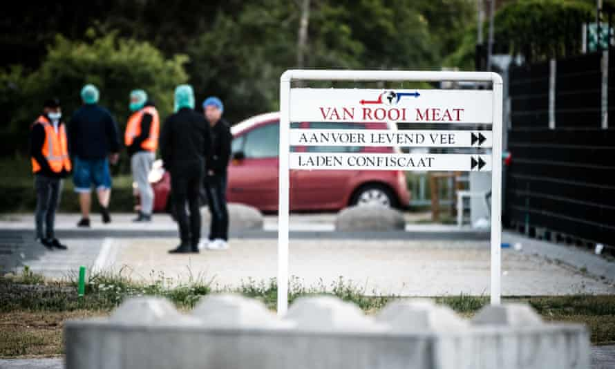 Workers arrive at the meat plant in Helmond