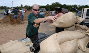 Locals fill up sandbags in preparation for Cyclone Debbie in Townsville.