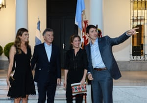 Argentinian President, Mauricio Macri (2-L), and his wife Juliana Awada (L), greet Canadian Prime Minister, Justin Trudeau (R) and Canadian First Lady, Sophie Gregoire Trudeau (2-R) during a meeting at Macri's official residence
