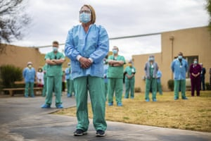 Roxanne Lee, manager of the Tucson Medical Center cath lab in Arizona, US, stands with nurses and other colleagues during a ceremony to remember those who have died of the coronavirus, on 19 January, 2021.