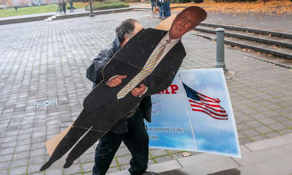 A protester carrying a cutout of Donald Trump at a Stop the Steal rally in Salem, Oregon, 7 November 2020.