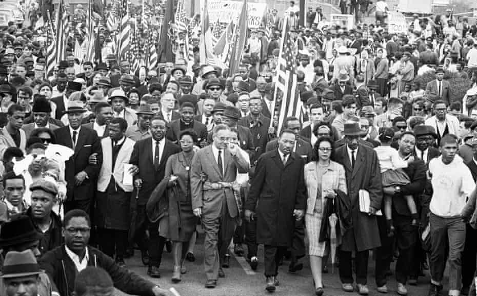 John Lewis (second from left in the main group, wearing a white tunic), Dr Martin Luther King (centre) and other civil rights activists arrive in Montgomery, Alabama having marched in nonviolent protest from Selma, 25 March 1965